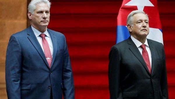 "<a class=""amazingslider-posttitle-link"" href=""https://www.alhoukoul.com/news-cuba-cuba-yes-people-shout-as-diaz-canel-arrives-in-mexico-city/"">Cuba 'Cuba, Yes,' People Shout as Diaz-Canel Arrives in Mexico City</a>"